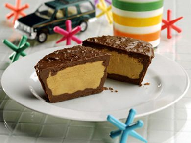 {Homemade Peanut Butter Cups} Who doesn't love the irresistible combo of chocolate and peanut butter? Our Test Kitchen has created what is sure to be your go-to chocolate candy recipe. Once you make our Homemade Peanut Butter Cups, you'll never buy store-bought again. | MrFood.com
