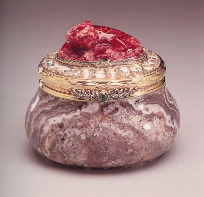 Faberge box carved out of amethyst, fitted with gold mounts, encrusted with diamonds and topped with a carved ruby animal, brought out of Russia by Felix Youssupov and sold to Cartier
