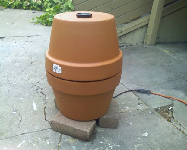 Cheap and easy to build redneck ceramic smoker: This is a slow cooking smoker. The process takes an overnight soak and most of next day cooking but it is cheap and works better than some hundred dollar metal smoker my neighbor got. Inspired by Alton Brown of Good Eats