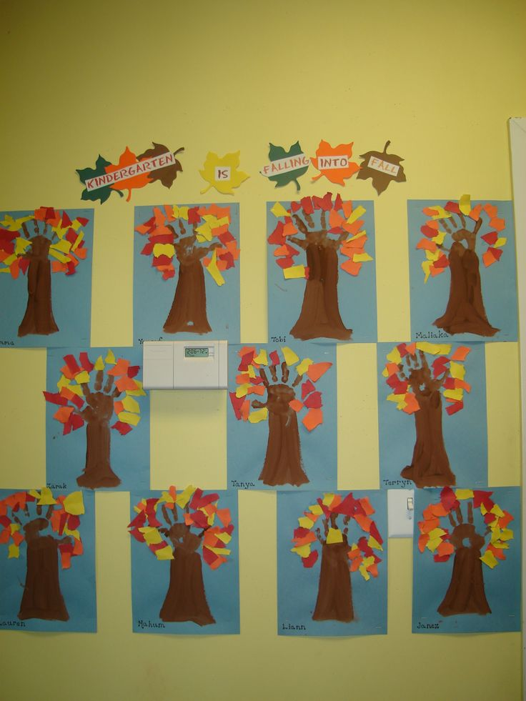 "Children made the ""Kindergarten is Falling into Fall"" display using ripped construction paper, brown paint and their handprints."
