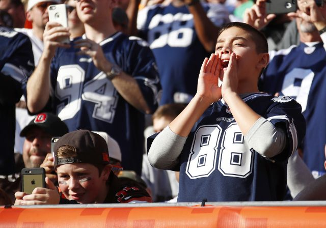 Cowboys vs. Browns:  35-10, Cowboys  -   November 6, 2017:    A Dallas Cowboys fan and a Cleveland Browns fan cheer during the game at FirstEnergy Stadium on November 6, 2016 in Cleveland, Ohio. (Photo by Gregory Shamus/Getty Images)