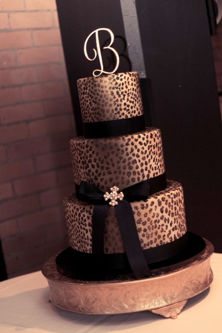 leopard wedding cake, with first letter of last name as the topper