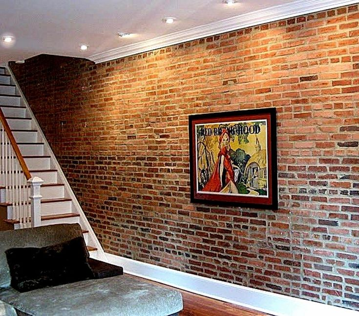 FAUX brick panels to get this look. Like to redo the wood wall down stairs