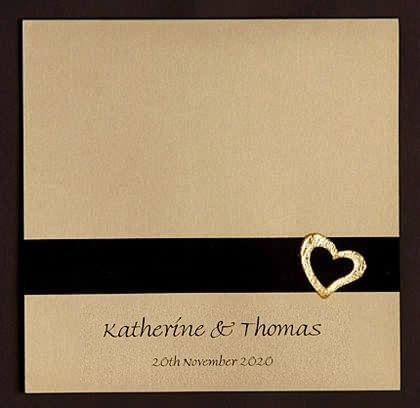 Gold wedding invite. Printed on gold card with black ribbon and a gold heart. The wedding celebration detail are printed on the inside of the folding card. www.kardella.com