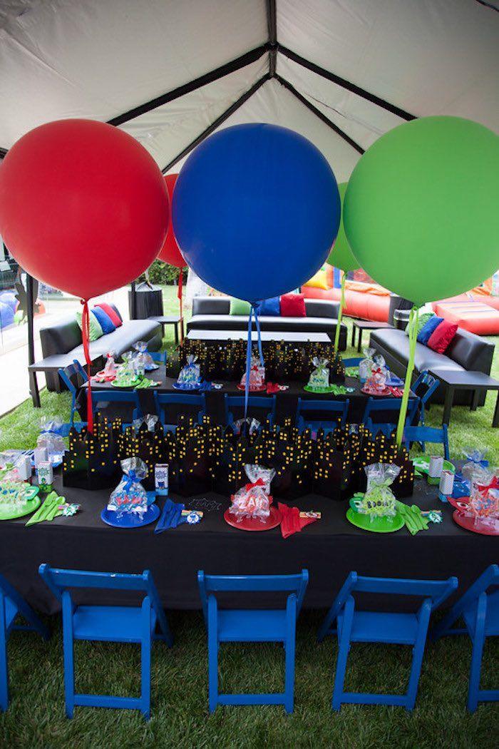 Party details from a PJ Masks Superhero Birthday Party via Kara's Party Ideas | KarasPartyIdeas.com (57) Backdrop Cityscape Skyline by Spritz available at Target. $2.99 each.