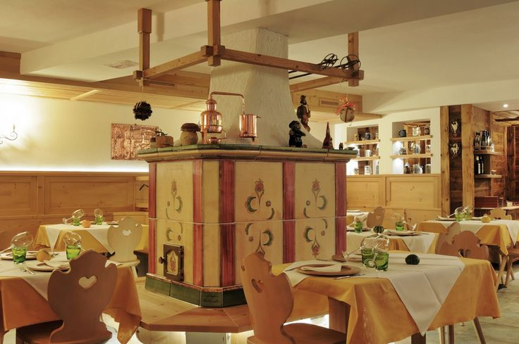 An exclusive hand-crafted stove typical of the area, natural materials sourced in our valleys and a touch of timeless elegance in the details and furnishings regale on the Due Pini Restaurant the class and personality synonymous with the finest places to eat in the mountains.
