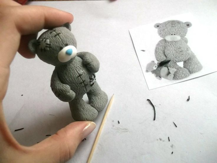 Try this sweet tutorial with RKT and Fondant or Gumpaste. Soo cute