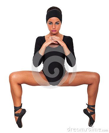 Woman dancer on her toes legs spread, isolated on white background