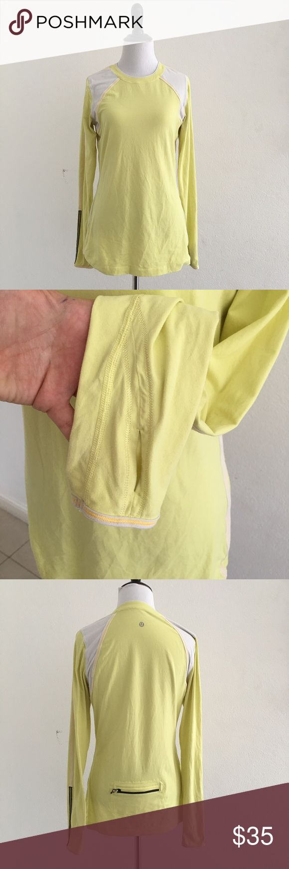 Lululemon Yellow Long Sleeve Top size 8 Preowned Lululemon Yellow Long Sleeve Top size 8. Has thumbholes. Has small light stain in front. Please look at pictures for better reference. Happy shopping! lululemon athletica Tops Tees - Long Sleeve