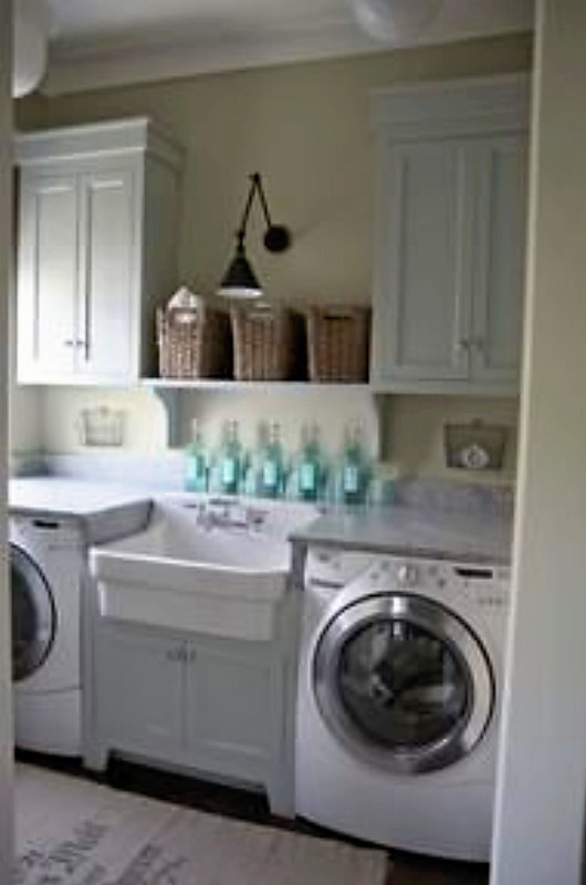 amazingly organized laundry room.  so now i must go reorg mine.....ugh