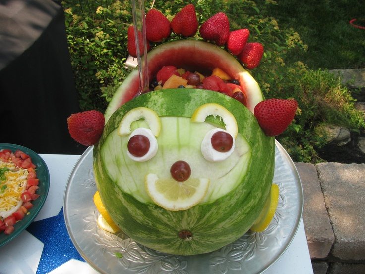 watermelon car, filled with fruit.
