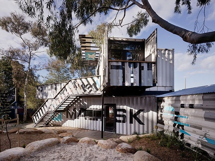 Beyond Sustainability. Skinner's Playground: Note the inventive way the containers have been sliced to create the railing and awning.  Left over pieces on the near wall.   The container ends are part of a balcony.  That star under the awning is an opportunistic design feature.