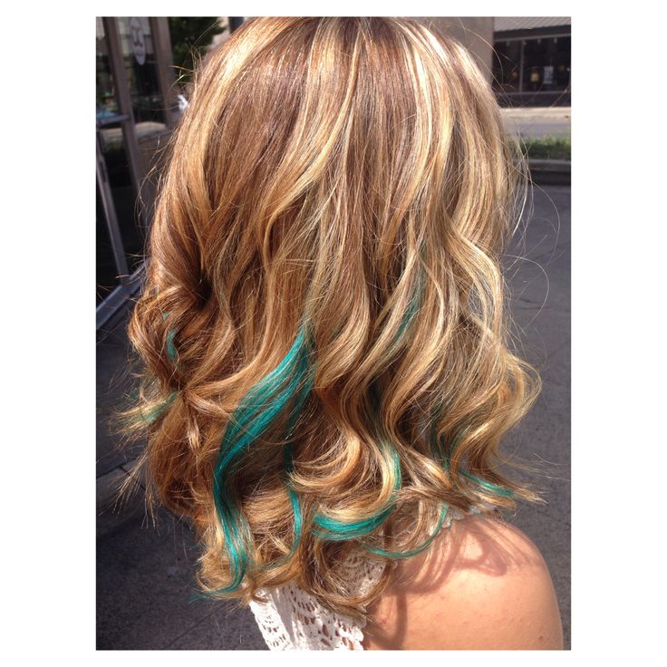 Blonde highlights, medium low lights, and turquoise streak extensions.