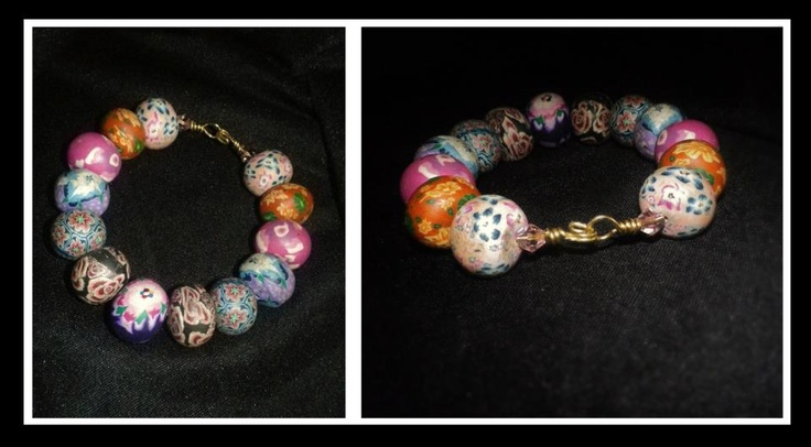Polymer beads on french wire bracelet  http://www.facebook.com/ZadiaDesigns