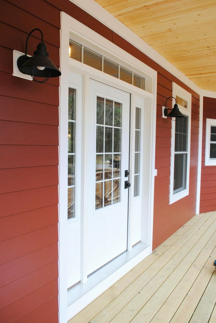 Exterior // Countrylane Red Siding by James Hardie / Black Barn Lights / 3/4 Light Front Door with Side lights and Transom / Pine Beadboard Porch Ceiling // PCW design/build