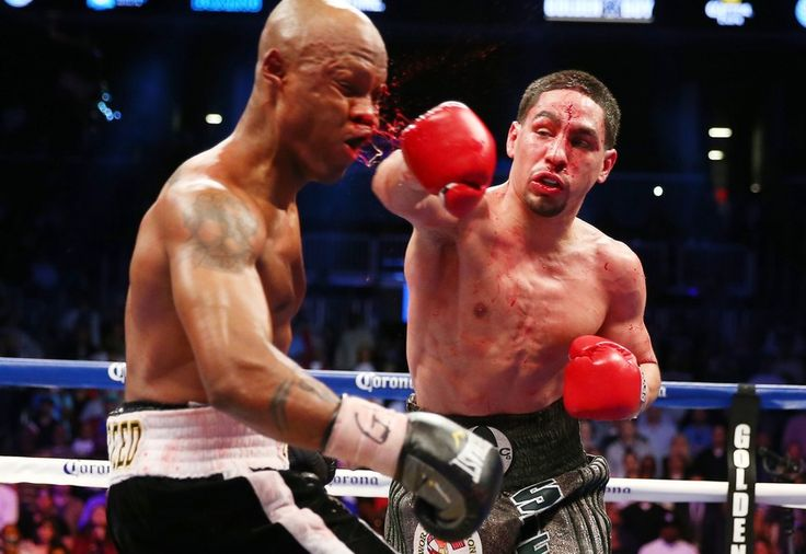 Danny Garcia lands a bloody punch on Zab Judah during their championship boxing match on April 27.