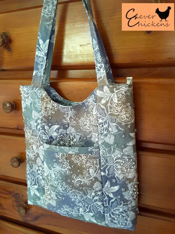 Quilted and hand-beaded tote bag