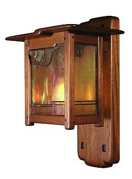 One of four dining-room sconces, made of mahogany and leaded iridescent glass.