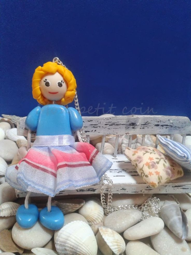 Handmade doll on a necklace