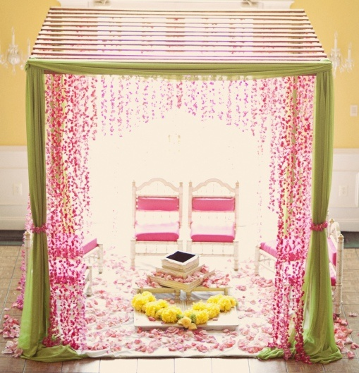 Pergola mandap with green fabric and fuchsia pink flower garlands