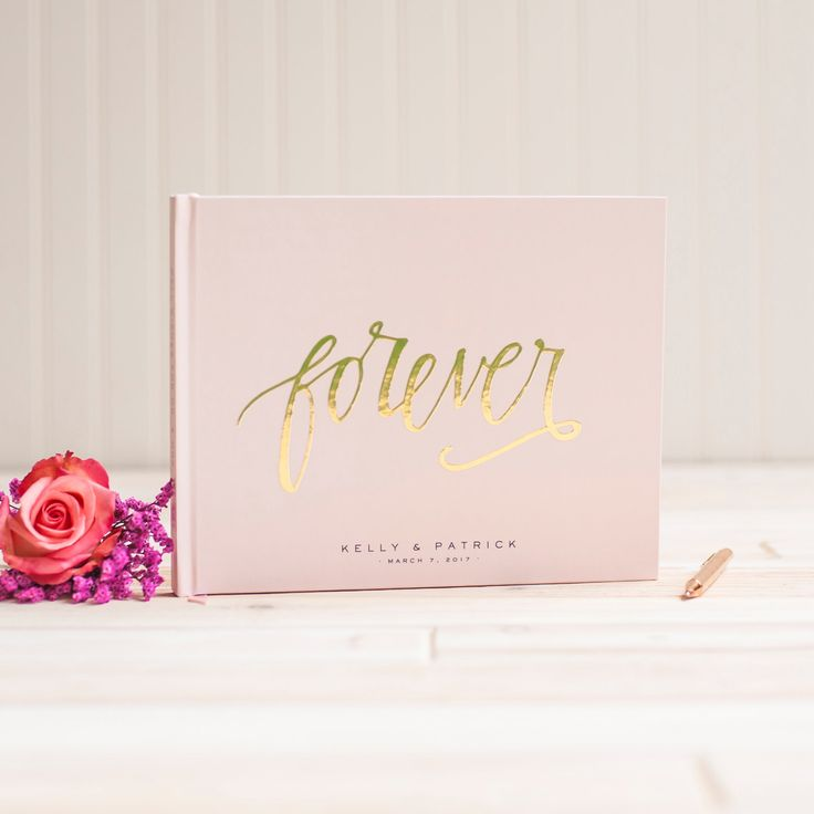 this wedding guest book in landscape thats blush pink with gold foil looks so good