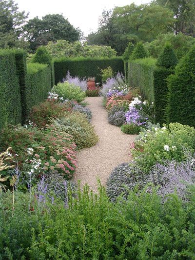 """The large garden is also vitually unchanged since it was described in 1756 as """"pleasant well-planted with fruit trees and a kitchen garden, all inclos'd with a substantial brick wall.""""  Hereis the cross border, which are surrounded by an 8-foot yew hedge.  Photo by Nancy Heraud What's about a maze in your garden, with little secret corners?  ?..."""