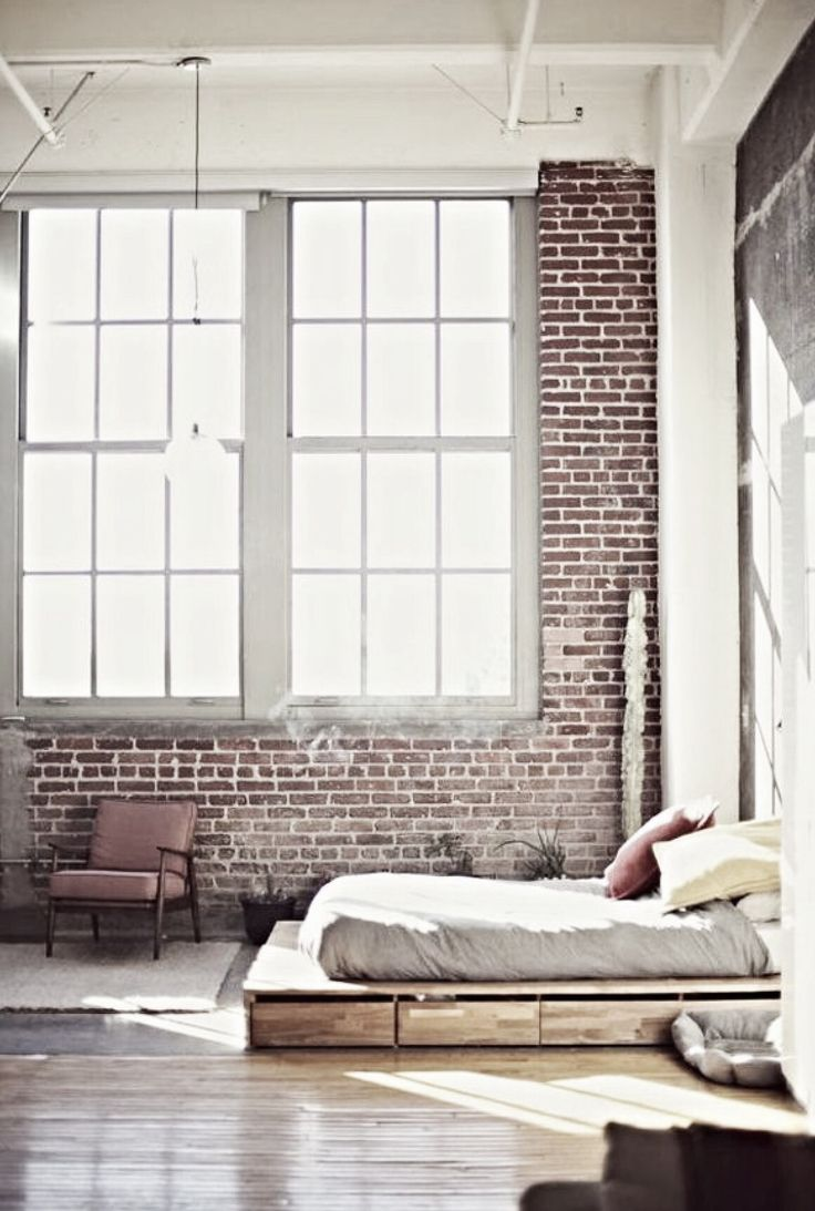 exposed brick and windows + low bed