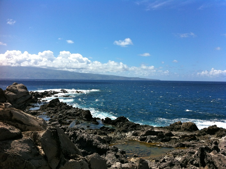 Hiking in Maui with beautiful views of the ocean.