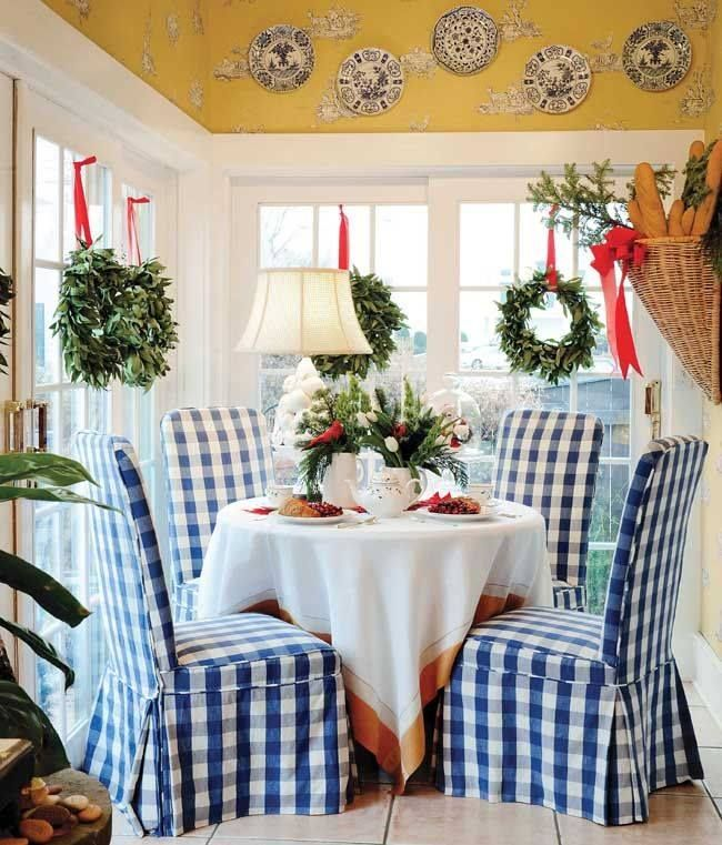 Love the blue and white check chairs with the yellow and white walls and trim.  My favorite colors for the kitchen!