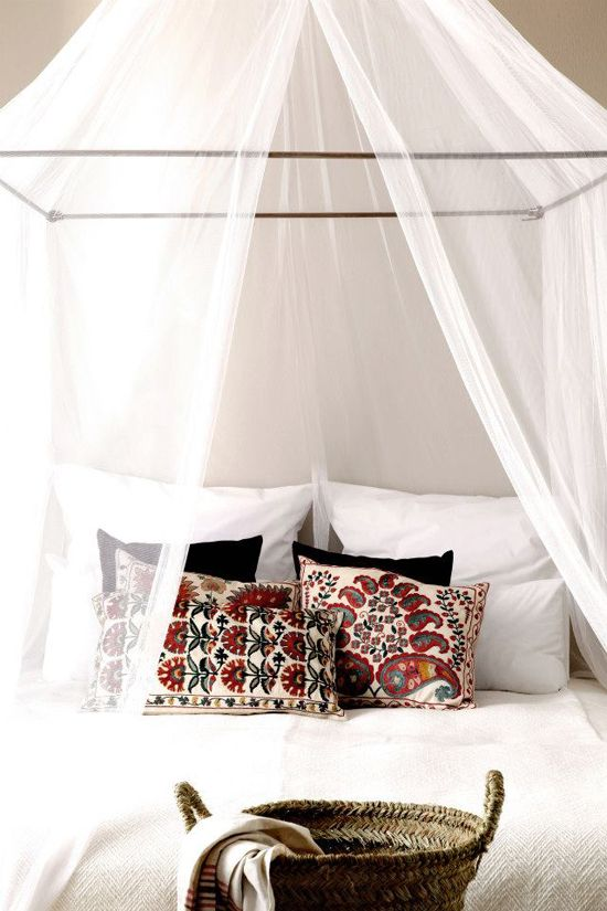 modern high wrought iron framed bed with mosquito netting in black and white theme [original pin ~ San Giorgio Mykonos bohemian luxury design hotel]