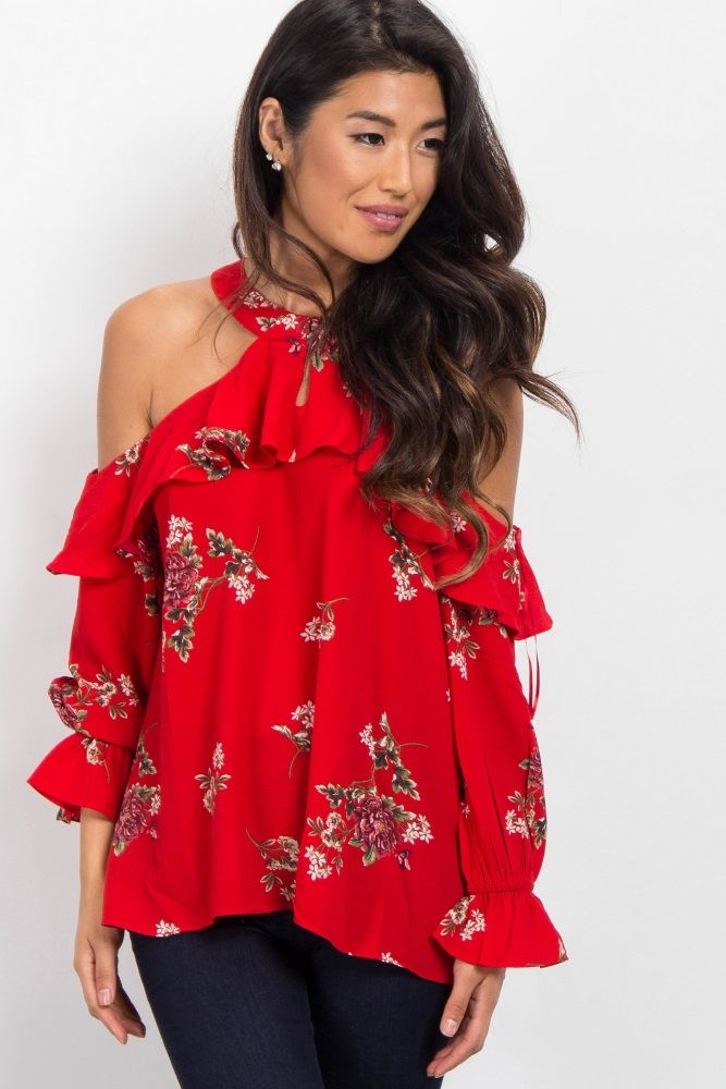 5c4117c3e4f4a A floral print open shoulder top. Ruffle trim. Cutout front. Long cinched  sleeves. Keyhole back with button closure. Rounded high neckline.