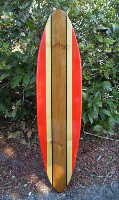 The original RedRail Classic Surfboard. Available in 2,3,4,5, and 6 foot sizes!  This classic style has an awesome old-school look. Beautiful red rails are lined with natural wood stringers. The center of the deck has a rich deep stained strip from bottom to top, lined with classic black pinstripes. This timeless classic tropical style surfboard artwork will be created from scratch just for you!  The natural aspects of each board, including knots and woodgrain tone, will vary per individual…