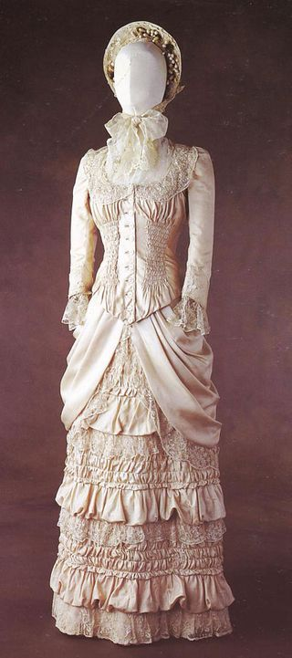 wedding apparel in the late 1800's | The cream silk wedding gown in late 1800s style could be considered as ...