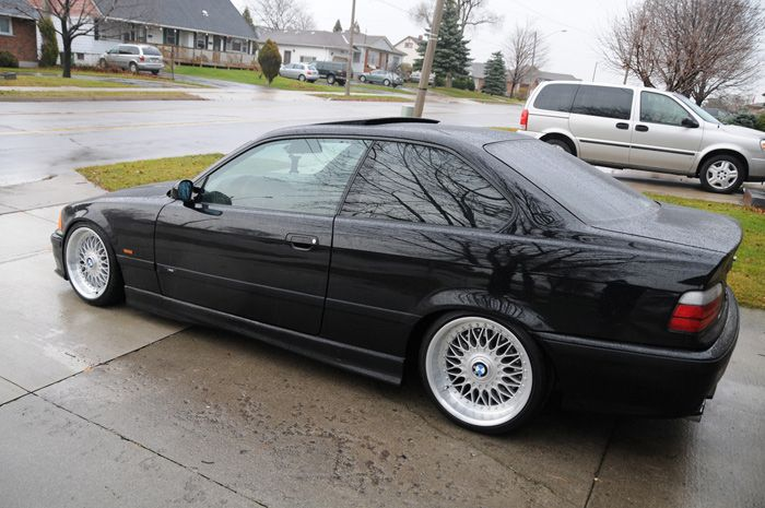 E36 BMW 3 Series in black with BBS wheels.