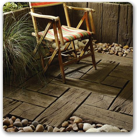 Railway sleepers as flooring, would love to use this in the Kitchen.