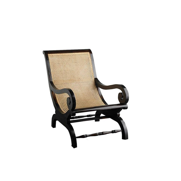 Our Keraton Carved lazy armchair , handcrafted in Indonesia from solid teak, is a striking addition to your home.