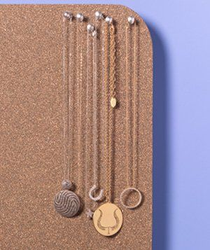 Corkboard as Jewelry Organizer  Prevent necklaces from tangling in your jewlery box by hanging them on a cork board with thumbtacks.