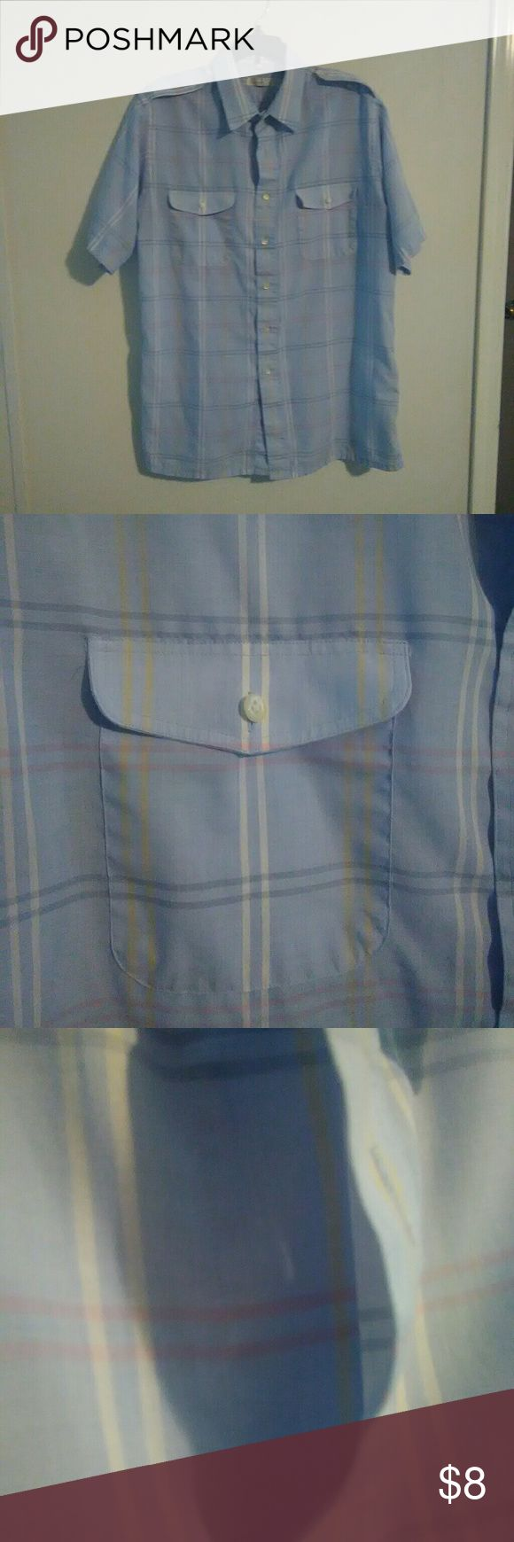 Christian Dior mens button down blue plaid L Christian Dior mens button down blue plaid short sleeve shirt. It is missing a button but no other flaws. Missing button shown in picture. Christian Dior Shirts Casual Button Down Shirts