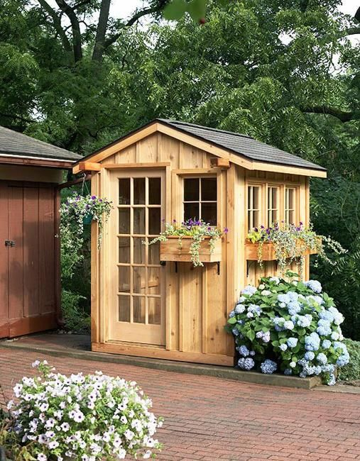 Small garden sheds look pretty providing great storage solutions for gardening tools and outdoor accessories
