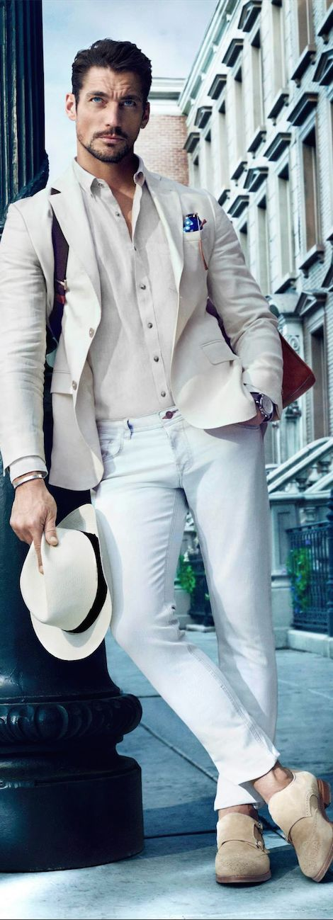 Shop this look on Lookastic:  https://lookastic.com/men/looks/blazer-dress-shirt-skinny-jeans-double-monks-messenger-bag-hat-pocket-square-watch/11896  — Beige Suede Double Monks  — White Straw Hat  — Light Blue Skinny Jeans  — Dark Brown Leather Watch  — Blue Polka Dot Pocket Square  — Beige Dress Shirt  — Beige Blazer  — Brown Leather Messenger Bag