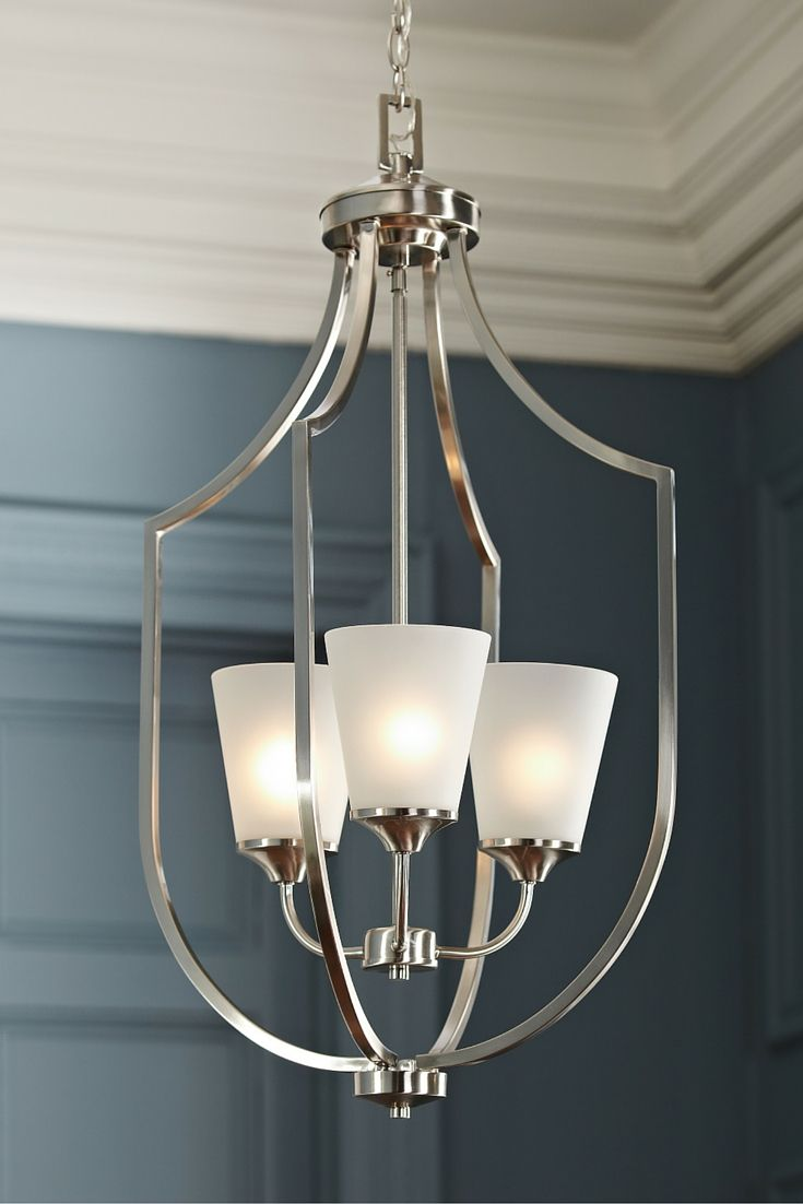 Elegant, long arms create symmetry in the transitional Hanford hall/foyer light by Sea Gull Lighting. Tapered Etched glass shades produce a soft uplight and make Hanford complementary to a wide array of décor from traditional to contemporary. Offered in both Brushed Nickel and Burnt Sienna finishes, the collection also includes chandeliers, pendants, a semi-flush mount and bath fixtures.