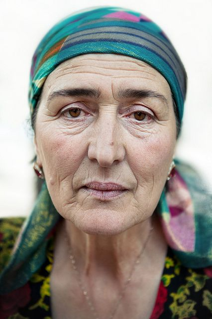Tajikistan portrait - A beautiful face with very sad and pensive eyes - her journey tells the world she has known many challenges in her life!