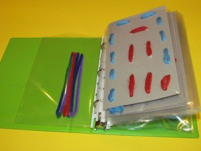 A busy book for sewing (and fine motor).  Like the use of cut pipe cleaners as needles for little hands.