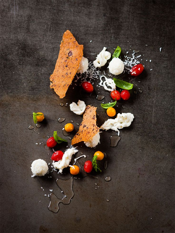 Baby roma tomatoes and gooseberries in basil & black pepper syrup, strachiatella, yoghurt snowballs, olive tuiles, basil granite by chef Luke Dale-Roberts. © The Test Kitchen - See more at: http://theartofplating.com/news/the-rising-star-of-south-africa/#sthash.Go3pJwHZ.dpuf