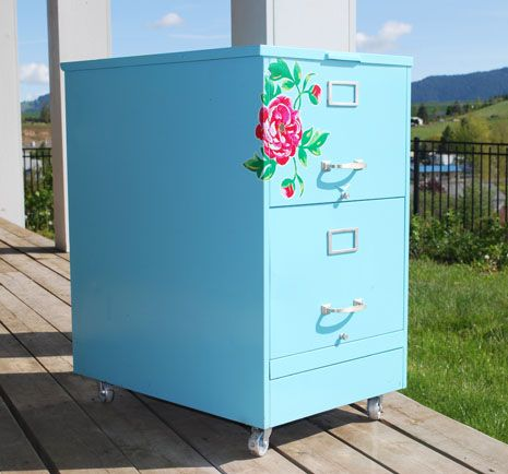 I never thought to spray paint my file cabinets and add decals to the outside, but I like the way this looks better than my boring white and black ones.