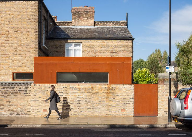 HÛT uses pre-rusted steel for extension to Victorian brick house in London