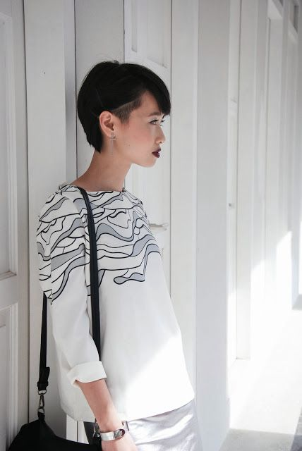 Bob haircut with an undercut on straight black-colored hair. Very chic