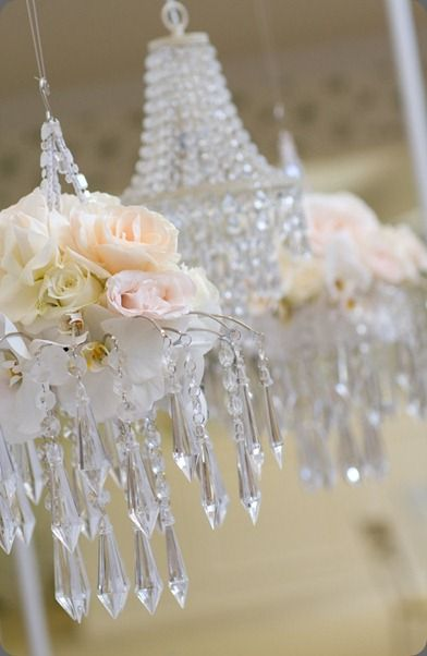 Wedding flowers aren't limited - as shown here, roses and orchids can adorn the chandelier, too! Shop roses, orchids, and other popular wedding flowers at GrowersBox.com!