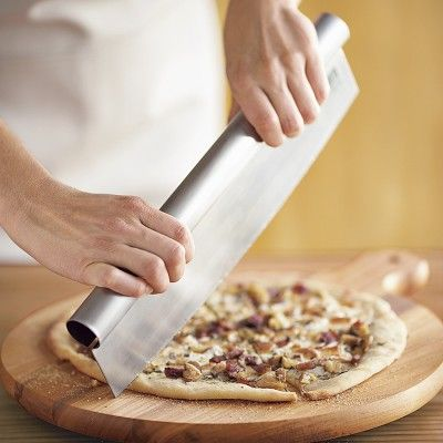I love the Bialetti Pizza Chopper on Williams-Sonoma.com.  Looks easier to use than a pizza slicer!