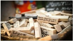 "A ""guest book"" consisting of Jenga blocks signed by the wedding guests."